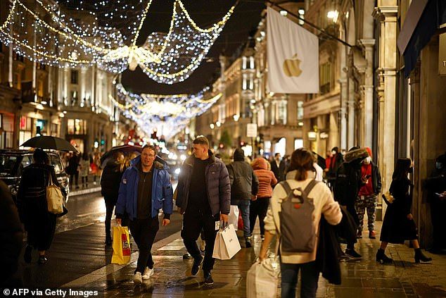 Mr Hancock chose his language carefully. He did not say the ¿new variant¿ was ¿causing¿ the spike in cases in London, he said it is merely ¿associated¿ with it ¿ not at all the same thing. Pictured: Shoppers in Regent Street, London