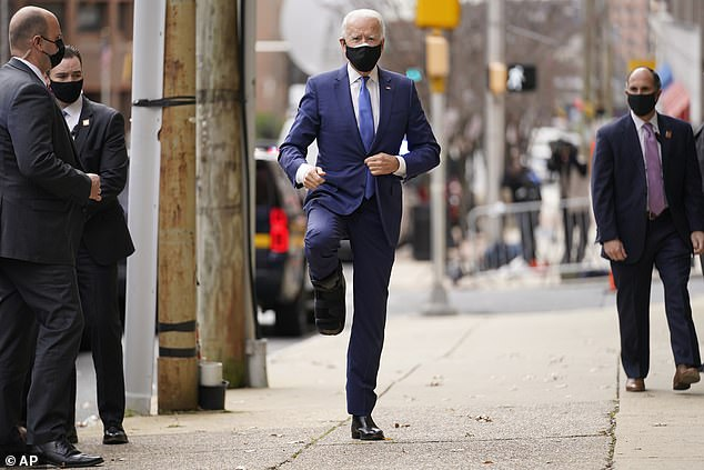 Earlier this month Biden fractured his foot while playing with his Germany Shepherd Major and was seen out using a black medical boot on his right foot. Biden pictured showing off his medical boot on December 1 in Wilmington, Delaware