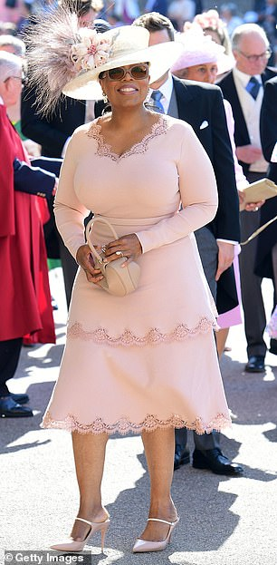Media mogul Oprah has grown close to both Meghan and Prince Harry, 36, and attended their wedding in May 2018 (pictured)