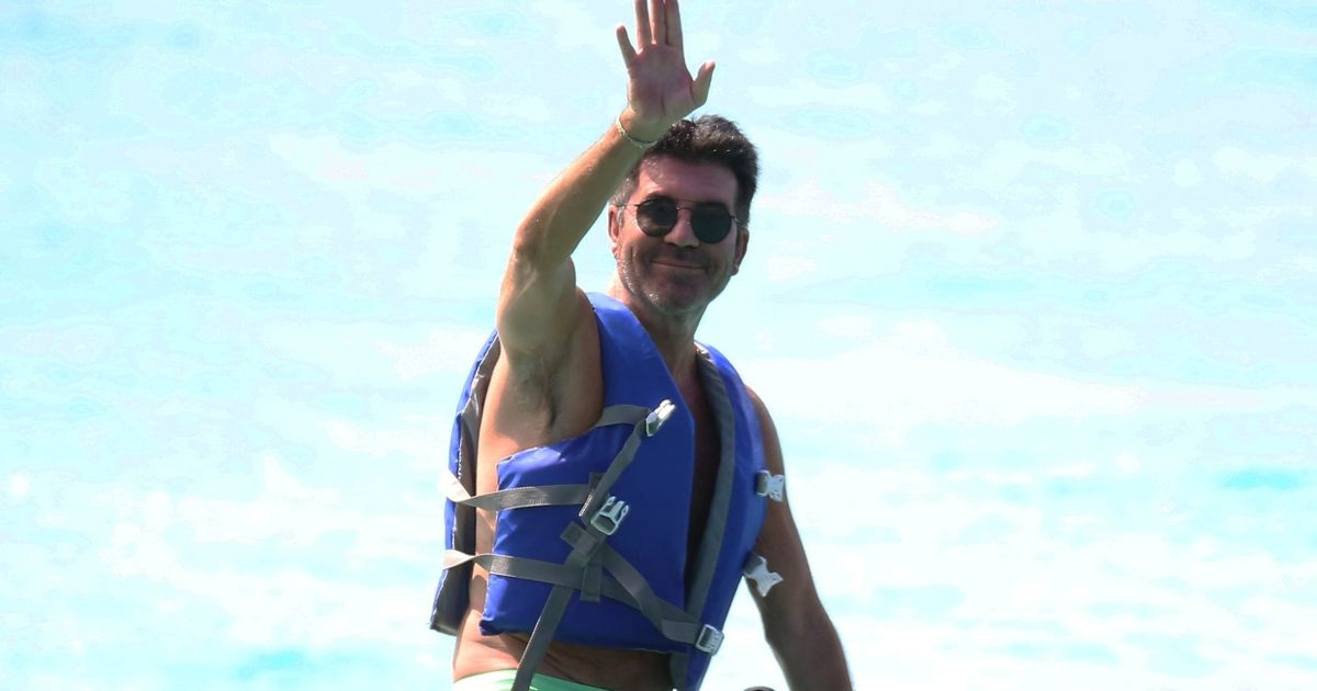 Simon Cowell rides jet ski in Barbados – four months after breaking his back