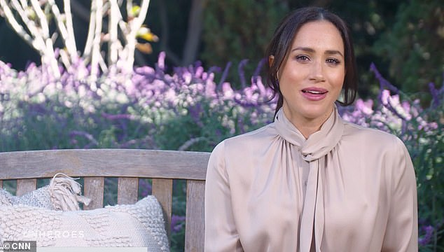 Meghan's appearance on CNN on Monday, pictured, when the duchess praised the 'quiet heroes' of the coronavirus pandemic who have supported communities