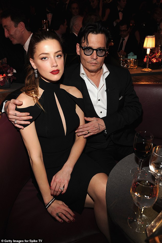 Bitter split: Heard and Depp have repeatedly accused each other of domestic abuse during their two-year marriage that ended in 2017 (pictured 2014)