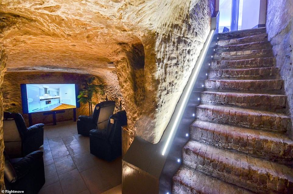 Unique entertainment space: The flat includes its own underground cave that doubles up as a private home cinema