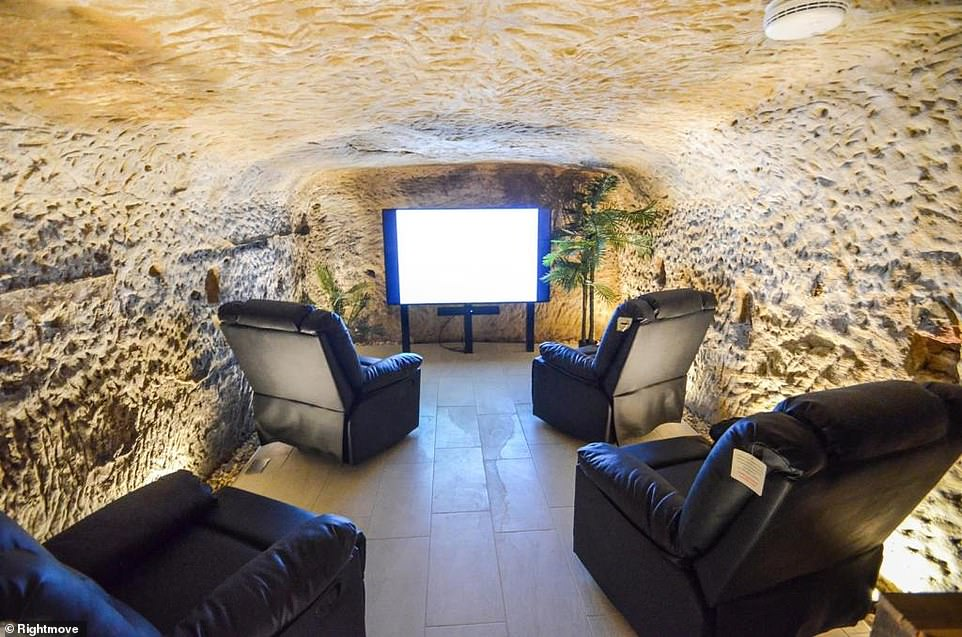 The cave cinema boasts reclining leather armchairs, a ventilation and heat recovery system and a sizeable wine chiller