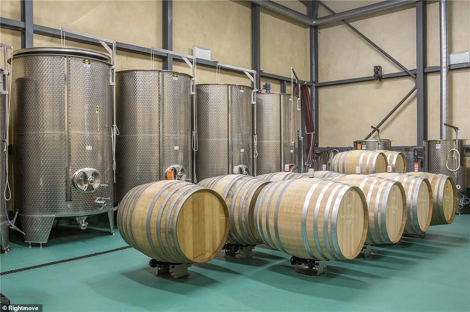 The vineyard is being sold as part of the property and it produces 100,000 bottles of wine a year