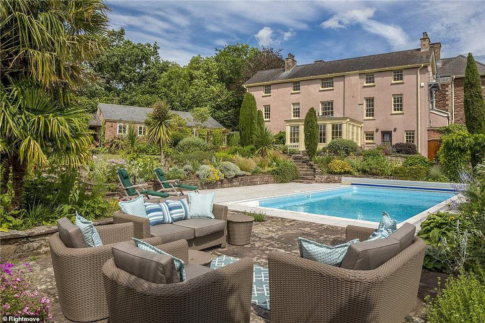 The mansion includes a swimming pool surrounding by a patio with plenty of seating areas
