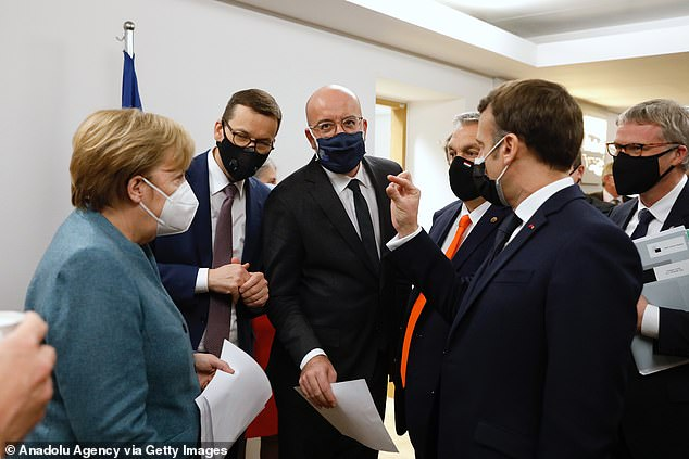 FRIDAY: Macron in a diplomatic scrum with German Chancellor Angela Merkel (left), uropean Council President Charles Michel (centre) and Hungarian PM Viktor Orban (right)
