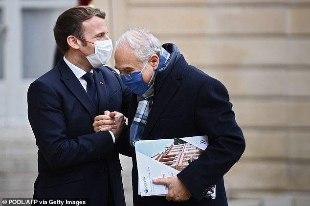 MONDAY: Macron shakes hands and holds 70-year-old Angel Gurria, the Secretary General of the Organisation for Economic Co-operation and Development, on Monday at the palace