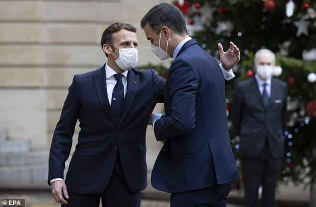 MONDAY: French President Emmanuel Macron pats Spanish Prime Minister Pedro Sanchez on the back as he arrives for work at the palace on Monday
