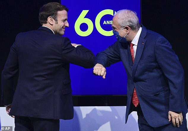 MONDAY: Macron, without a mask, bumps elbows with the OECD's 70-year-old Secretary General Angel Gurria on Monday