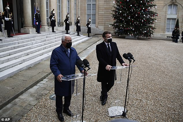 WEDNESDAY: Macron, right, and Portuguese Prime Minister Antonio Costa answer reporters