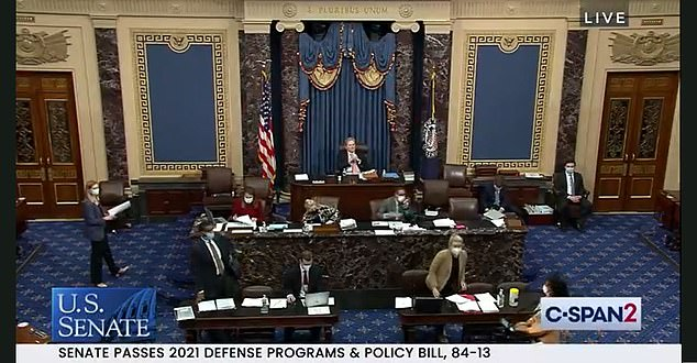 The Senate voted overwhelmingly for a defense bill Friday that President Donald Trump has threatened to veto, in a vote 84-13
