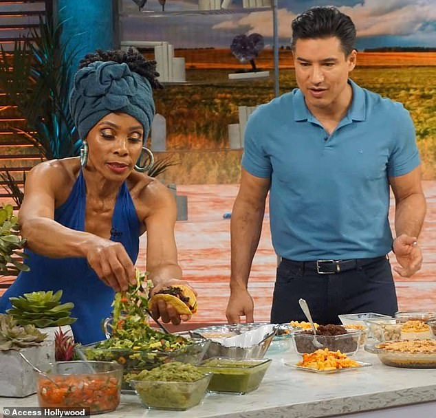 Davis, who credits her appearance to her vegan lifestyle, gave up meat and dairy more than 20 years ago. She's pictured cooking with Mario Lopez on Access Hollywood