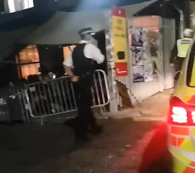 Footage from Hackney Wick captured officers as they attempted to break up the gathering and 'encourage them to disperse' in line with coronavirus rules in the capital. Pictured: Police in east London