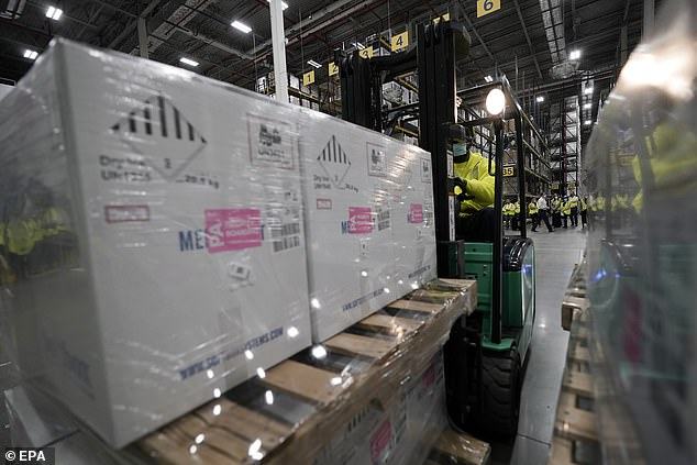 The vaccine, co-developed by German partner BioNTech, is being shipped from the Michigan Pfizer plant using containers with dry ice and GPS-enabled sensors