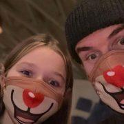 David Beckham and Harper wear matching Rudolph face masks on Lapland trip