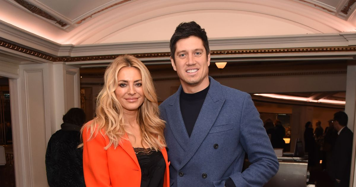 Vernon Kay and Tess Daly look smitten as they snuggle up on 'special' date night