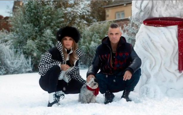 Robbie Williams and Ayda in a snowy scene from Instagram