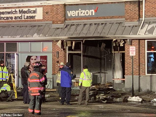 The Verizon store was completely destroyed when the car crashed into it on Thursday