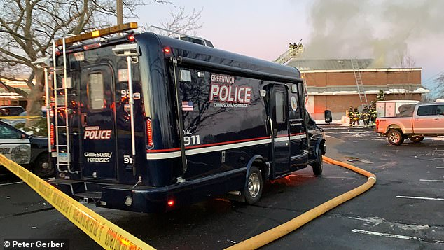 Pictured: A heavy police response to the car accident and fire at the Greenwich shops