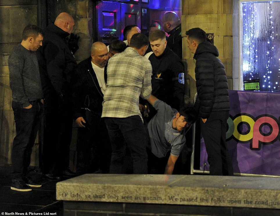 A man appears to have fallen over while exiting a club in Newcastle in 2019