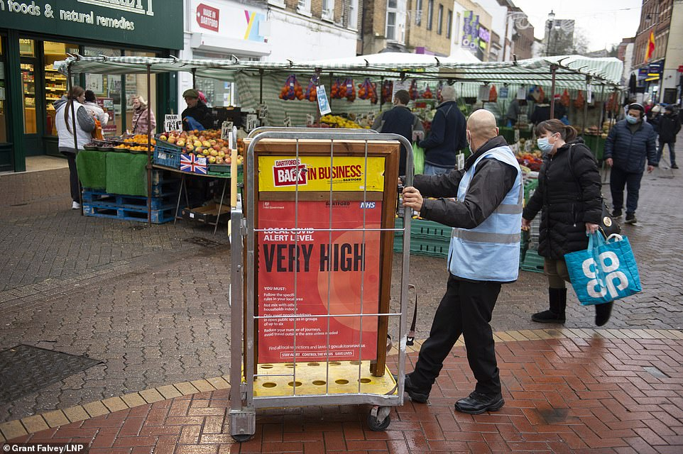 Meanwhile a Kent marketplace put up signs warning pedestrians of the Covid risk in the region. Shoppers were seen walking around