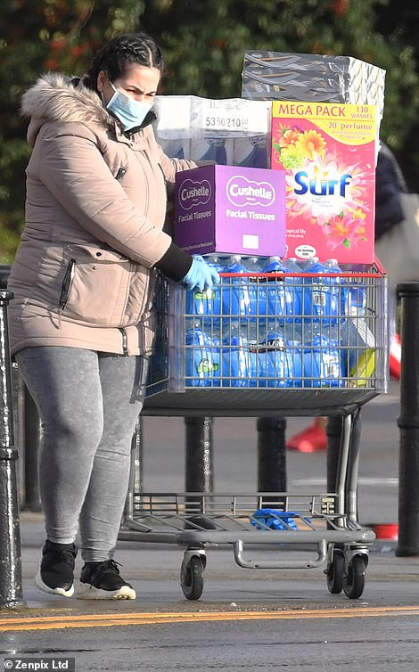 Shoppers were seen with trolleys piled high with essentials as winding queues formed outside Costcoin Birmingham