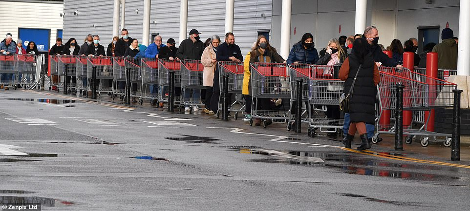 Lines of trolleys were seen outside Costco in Manchester on Saturday as Christmas day draws nearer and home delivery slots book up