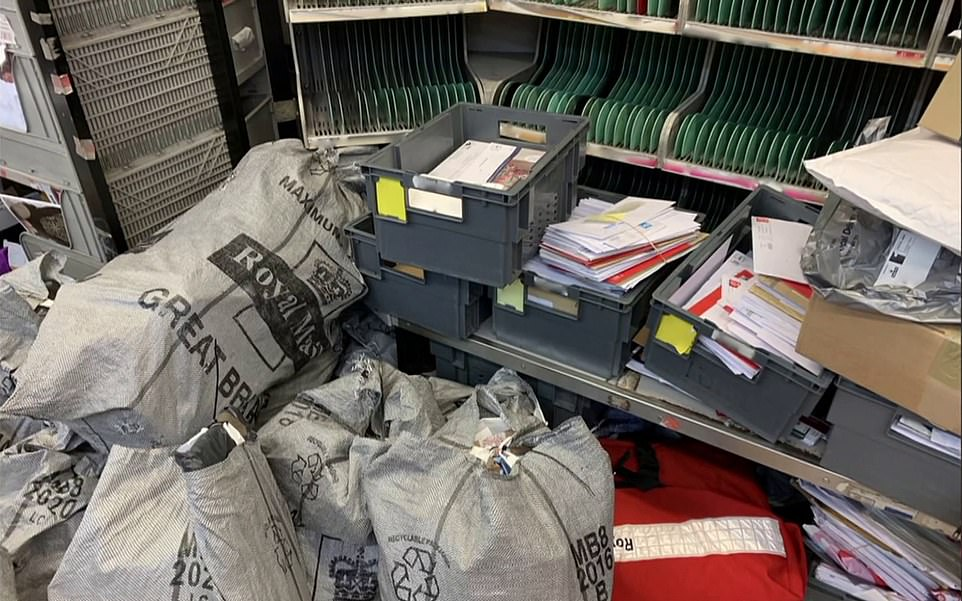 Thousands of presents remain buried in mountains of post bags at sorting offices, it has been revealed. Pictured is theRoyal Mail sorting office in Manchester