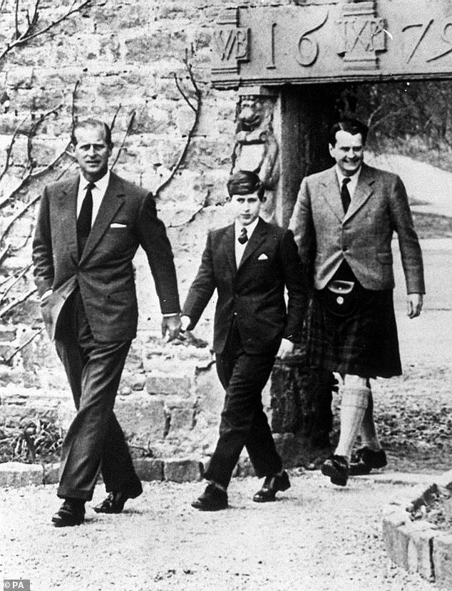 Prince Philip, pictured left with his son Prince Charles  and Captain Iain Tennant, chairman of the Gordonstoun Board of Governors at the heir to the throne's first day at school
