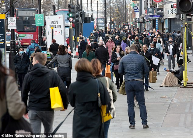 News of the latest crackdown came as countless Britons flocked to the country's high streets (Oxford Street, pictured) and supermarkets today as they stocked up on Christmas essentials