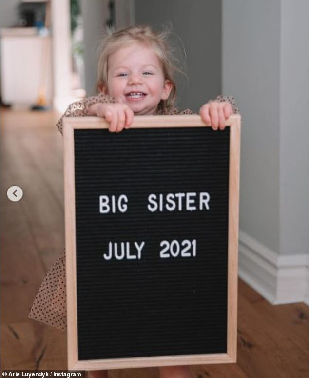 Proud sister-to-be:Arie shared the happy news on his Instagram account, with a lovely gallery of photos that featured the couple's one-year-old daughter Alessi Ren
