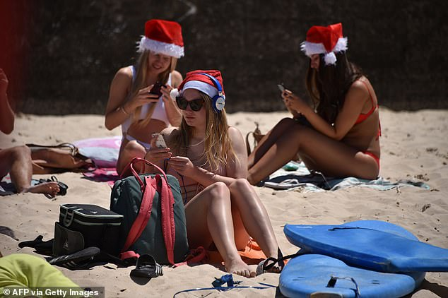 Bondi Beach on Christmas Day 2018. The time-honoured tradition for young backpackers of flocking to Bondi will be rained out this year, the weather bureau has said