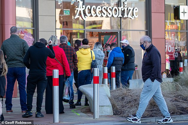 Shoppers were queuing outside shops in Northamptonshire, as the British Retail Consortium described the Government's latest response to growing Covid cases as 'deeply unhelpful'