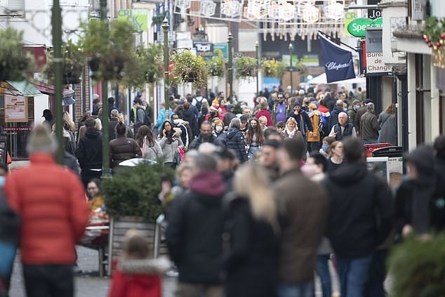 Studies are being carried to establish whether existing vaccines will be effective against the new Covid-19 variant - but shoppers were undeterred in Horsham this afternoon