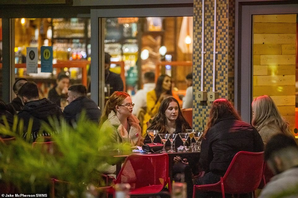 After drop in the number of infections, Bristol was one of few areas to have restrictions relaxed meaning different households could meet outdoors. Pictured: people drink at a restaurant in Bristol where they are now under tier 2 restrictions