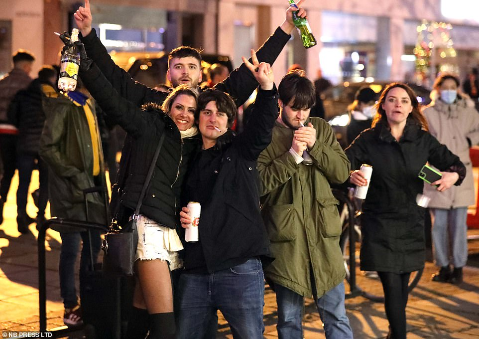 Revellers in city of York enjoy the more relaxed tier 2 restrictions by taking to the streets on last weekend before Christmas