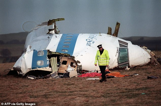 243 passengers and 16 crew, 190 of them Americans heading home for the holidays, were killed when a bomb exploded in the hold of Pan Am Flight 103 in the skies over Lockerbie, Scotland, in December 1988, showering the town in debris (pictured)