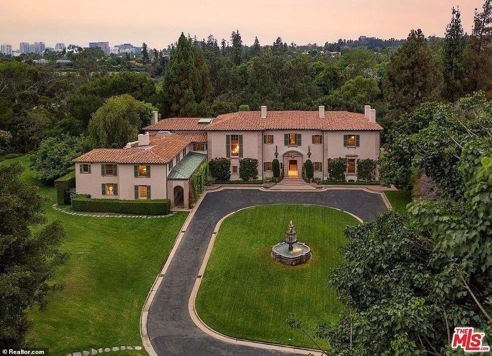 Disick then took a stroll around the even more opulent $115 million Owlwood Estate nearby (pictured)