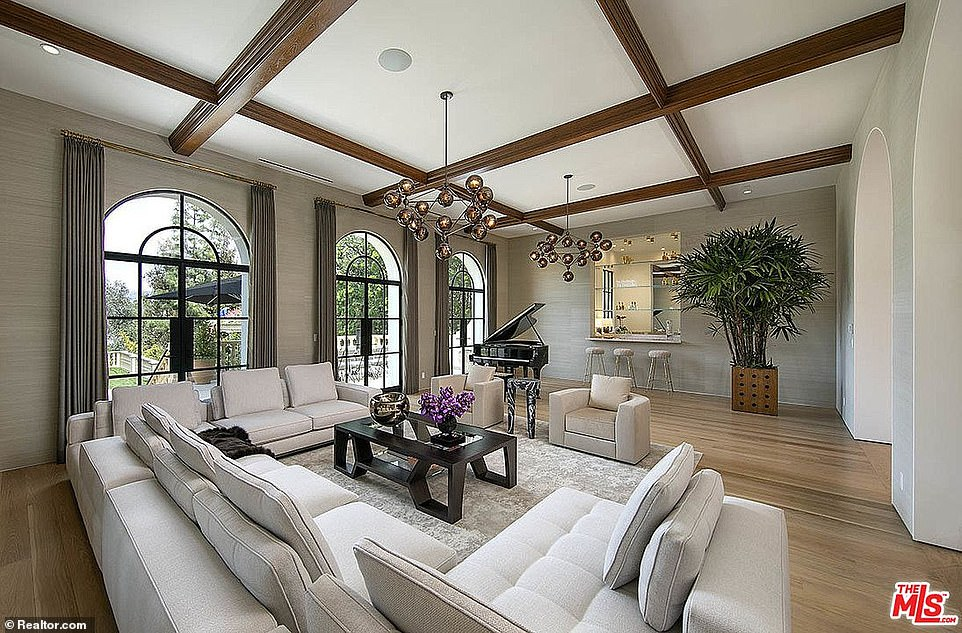Hilton and Hyland's property listing describe the nearly $69,950,000 mansion as 'fit for a mogul' with over 31,000 sq ft interior and soaring 27 ft ceilings
