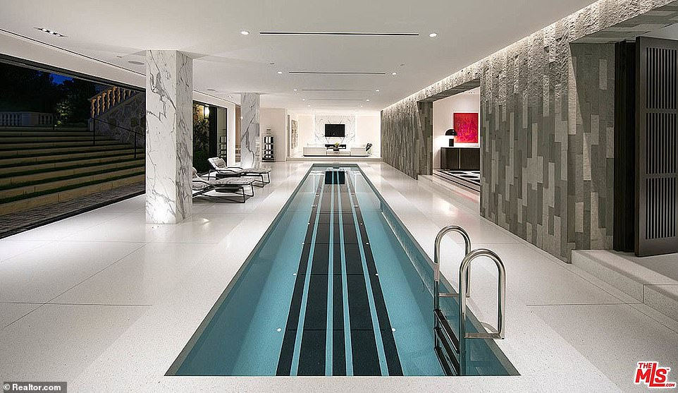 The lower level includes a wine cellar, movie screening room, a sauna and an indoor pool