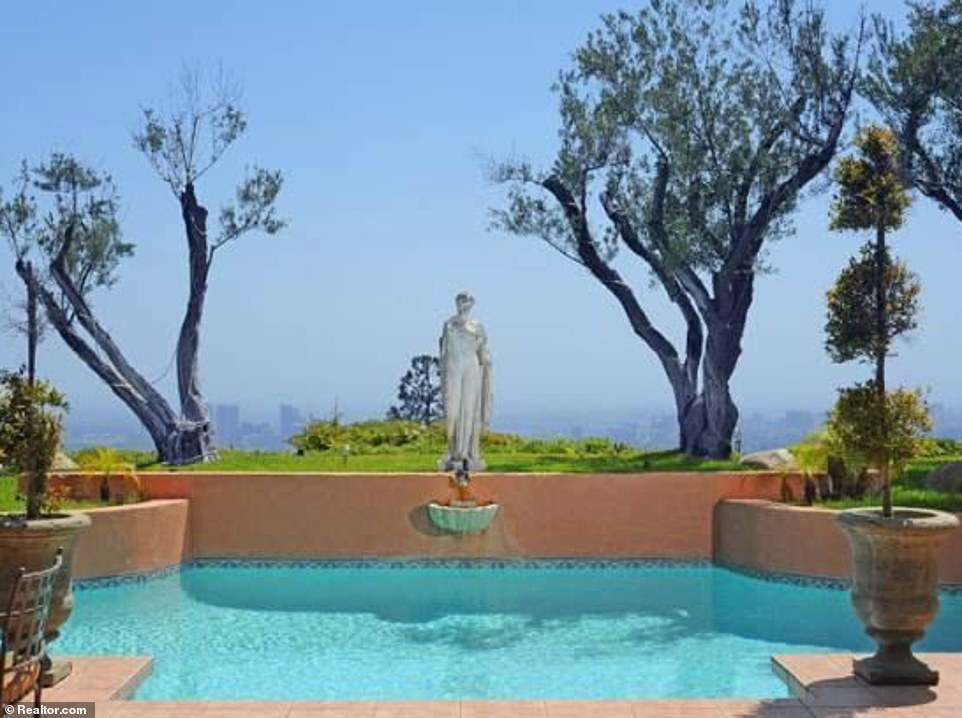 From the outdoor swimming pool there are breathtaking views of the city, billed as one of the best 180 degree unobstructed views in the star-studded Trousdale Estates neighborhood near Hollywood