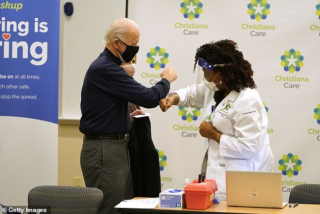 President-elect Joe Biden fist bumps nurse practitioner Tabe Masa after the President-elect received a COVID-19 Vaccination at ChristianaCare Christiana Hospital