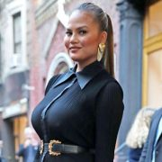 Chrissy Teigen Shows Off Implant-Free Breasts In Swimsuit As She Struggles To Make Them Go 'Up'