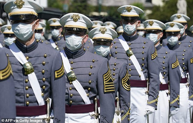 A calculus test administered in May 2020 resulted in 73 allegations of cheating. Unaffiliated cadets above attend their graduation at West Point