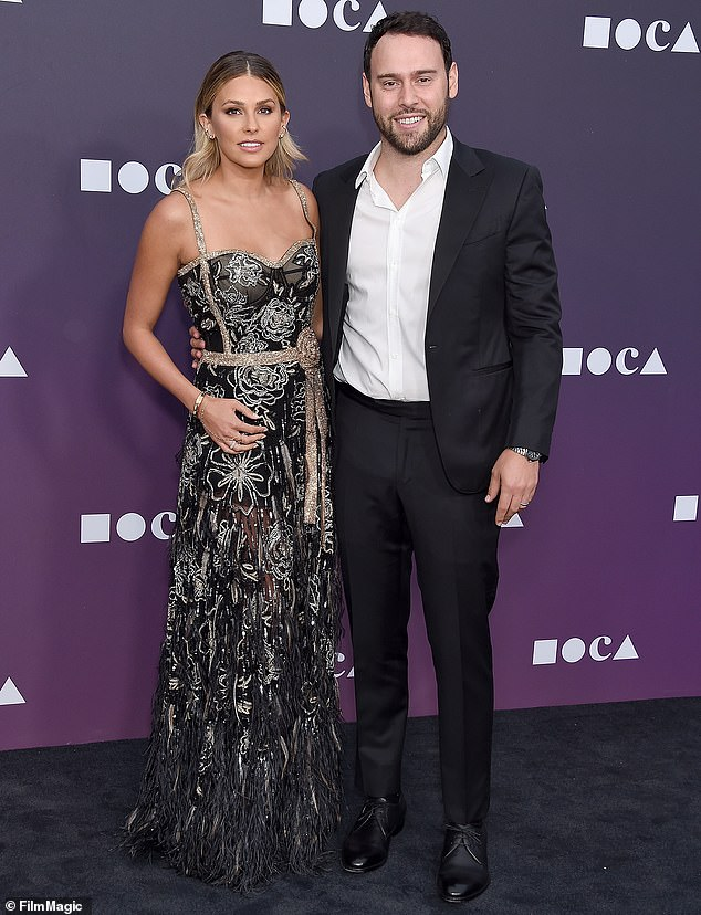 Another connection: Gomez attended Scooter Braun's party celebrating his wife, Yael, becoming a U.S. citizen in February. Braun has been Grande's manager for years