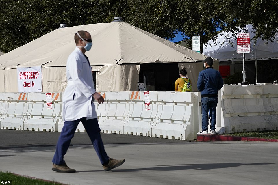 A medical tent outside the emergency room at UCI Medical Center in Irvine last week.Los Angeles County's health services director, Dr. Christina Ghaly, said plans for rationing care need to be established because 'the worst is yet to come'