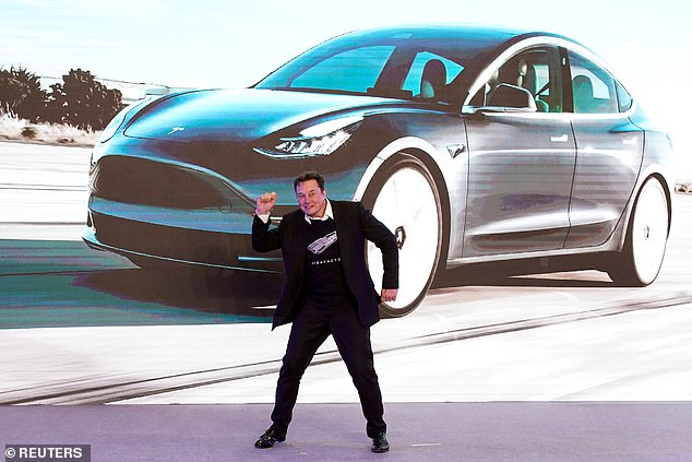 Musk dances during a delivery event for Tesla China-made Model 3 cars in Shanghai in January