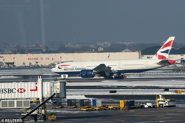 A British Airways plane arriving at JFK on Monday, one of dozens that flew in throughout the day, while more than 40 other countries cut off British travel