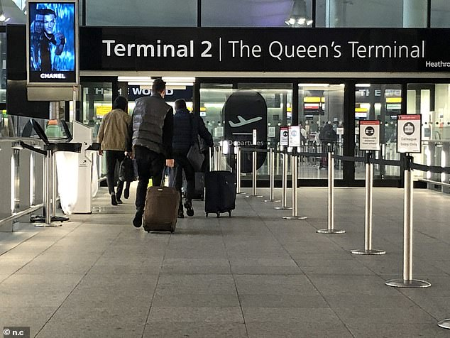 The restrictions were put in place after a mutant strain of coronavirus was identified in the UK. Pictured: Passengers arriving at Heathrow Airport